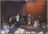 Unknown pianist, Ed Polcer, unknown bassist and Butch Miles [photograph, front]