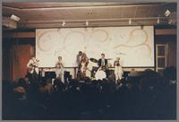 Unknown guitarist, Clark Terry, unknown bassist, James Moody, Butch Miles and Al Grey [photograph, front]