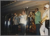 Buddy Tate, Al Grey and unknown musicians [photograph, front]