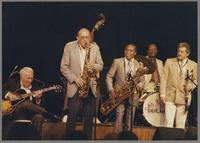 Herb Ellis and Haywood Henry with unknown musicians [photograph, front]
