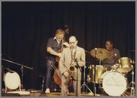 Unknown bassist, Al Cohn and Panama Francis [photograph, front]