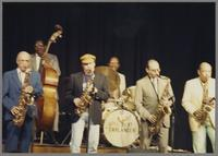 Flip Phillips, Major Holley, Phil Woods, unknown drummer, Al Cohn and Marshall Royal [photograph, front]