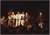 Unknown guitarist, Ray Brown, Red Holloway, Harry Sweets Edison, Butch Miles, Scott Robinson and Urbie Green [photograph, front]