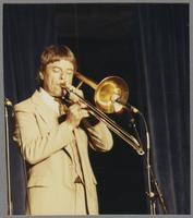 Bill Watrous playing trombone [photograph, front]