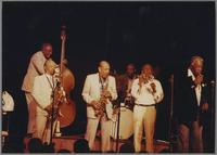 Milt Hinton, Red Holloway Marshall Royal, Joe Newman, Joe Williams and unknown drummer [photograph, front]