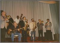 George Chisolm, Herb Ellis, Major Holley, Ken Peplowski, Scott Hamilton, Urbie Green and Dick Johnson [photograph, front]