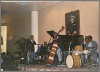 Buster Cooper, Jay McShann, Victor Gaskin and unknown drummer [photograph, front]