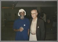 John Heard and unknown man [photograph, front]