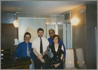 Monk Rowe, Tim Hicks, Mike Woods, and Mary Kopcz [photograph, front]