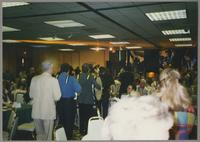 Band marching through room [photograph, front]