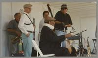 Dave Pell, John LaPorta, unknown man, Jay McShann, and unknown man [photograph, front]
