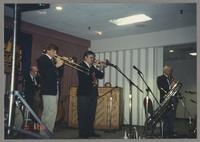 Dan Barrett and undentified band members [photograph, front]
