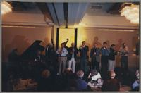 Unknown pianist, Bucky Pizzarelli, Jay Leonhart, Allan Vaché, unknown bass player, Jim Galloway, Randy Sandke, Ken Peplowski, Peter Ecklund, Dan Barrett, and Scott Robinson [photograph, front]