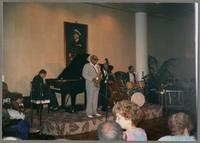 Benny Carter, Alan Dawson, and unknown men [photograph, front]