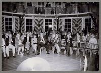 Gropu photograph of people seated in the Fillius Events Barn [photograph, front]