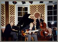 Dave McKenna, Bucky Pizzarelli, and Michael Moore [photograph, front]