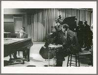 Erroll Garner, Bobby Rosengarden, and unknown band [photograph, front]