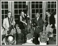 Monk Rowe, Genevieve Rose, Claude Williams, and Mark Copani [photograph, front]