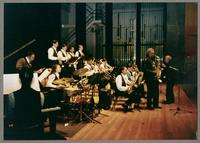 Mike Woods, Robert Watson, Rick Compton, and the Proctor High School Jazz Band [photograph, front]